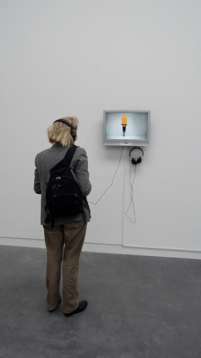 Visitor watching 'Easy to love, but hard to live with' | Museum De Pont | Karin van Pinxteren