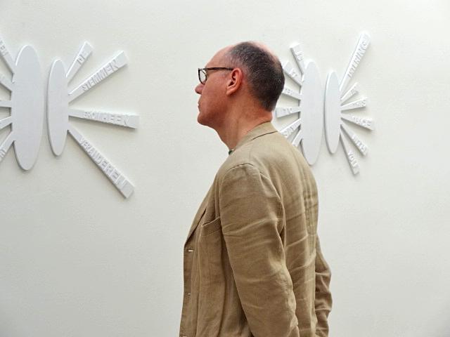 Visitor looking at The Correspondents @ Galerie Mieke van Schaijk 's-Hertogenbosch